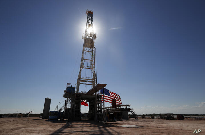 FILE- This July 29, 2020 photo shows an oil rig in Midland, Texas.  U.S. wholesale prices shot up an unexpected 0.6% in July,…