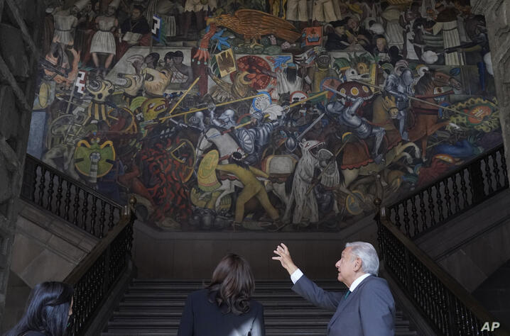 Vice President Kamala Harris listens as Mexican President Andres Manuel Lopez Obrador talks about The History of Mexico mural…