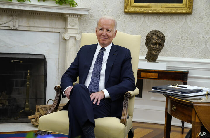 President Joe Biden looks on as he meets with German Chancellor Angela Merkel in the Oval Office of the White House, Thursday,…