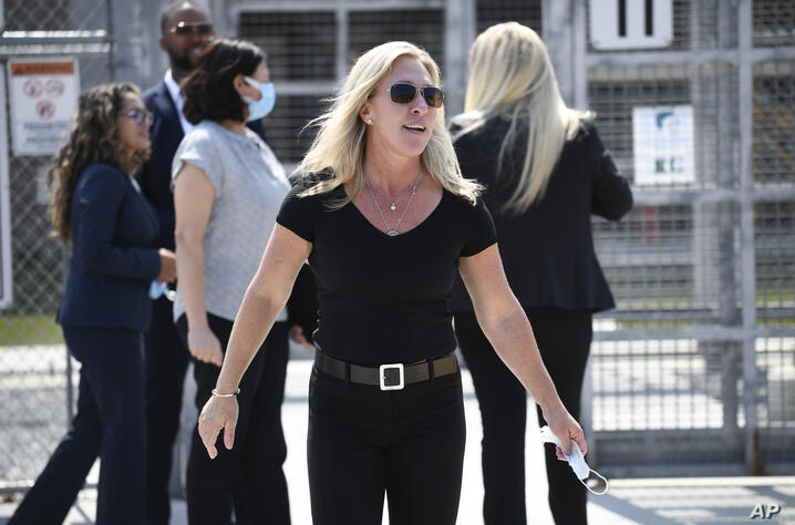 U.S. Rep. Marjorie Taylor Greene, R-Ga., walks out of the Otay Mesa Detention Center after touring the facility, Wednesday,…