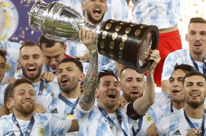 Argentina's Lionel Messi holds the trophy as he celebrates with the team after beating 1-0 Brazil in the Copa America final…