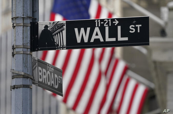 FILE - In this Nov. 23, 2020, photo, a street sign is displayed at the New York Stock Exchange in New York. S&P DJ Indices is…