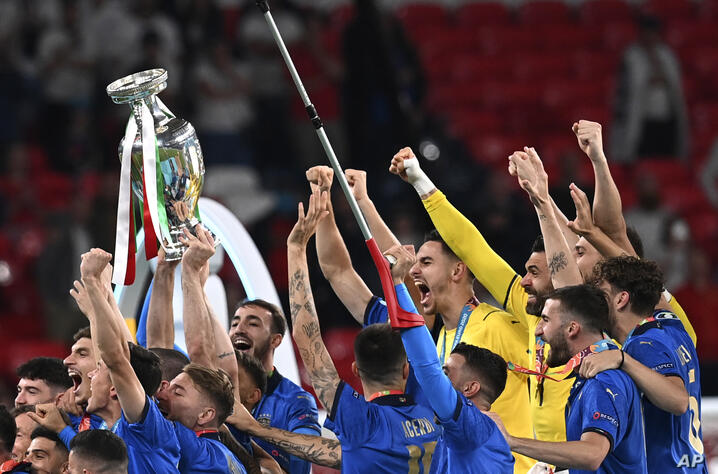 Italy's players celebrate with trophy after winning the Euro 2020 soccer championship final match between England and Italy at…