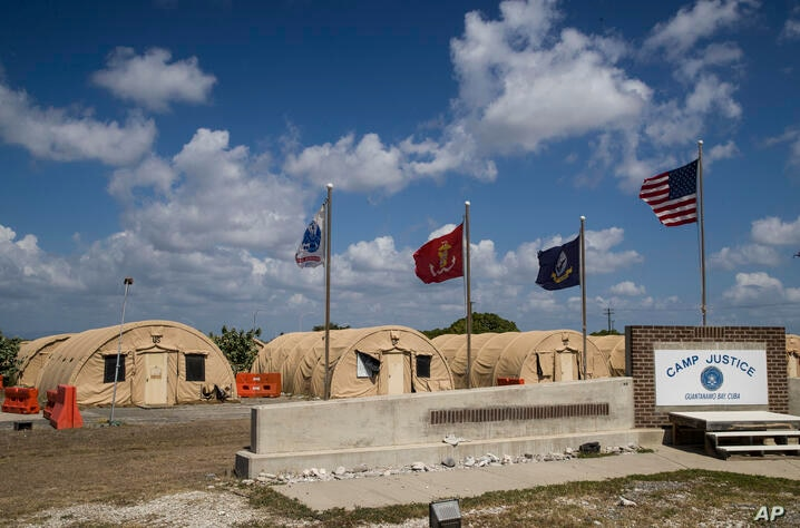 In this photo reviewed by U.S. military officials, flags fly in front of the tents of Camp Justice, Thursday, April 18, 2019,…
