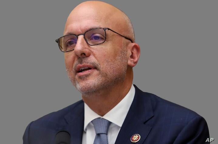 Ted Deutch headshot, as US Representative of Florida, graphic element on gray