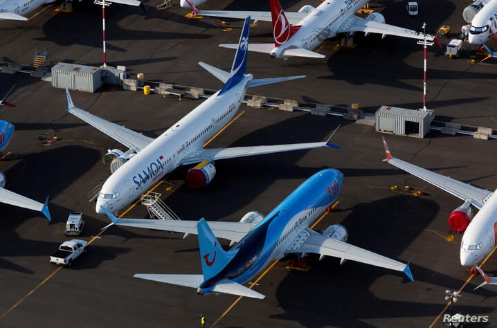 FILE PHOTO: Boeing 737 Max aircraft are parked in a parking lot at Boeing Field in this aerial photo over Seattle