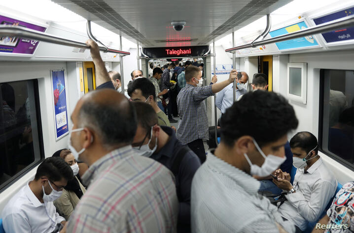 Iranians wearing protective face masks ride the metro, following the outbreak of the coronavirus disease (COVID-19), in Tehran