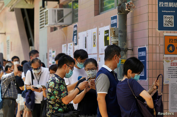 People line up to vote in the primary election aimed at selecting democracy candidates for the September election, in Hong Kong