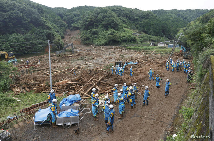 Police officers search for missing people at a landslide site caused by a heavy rain in Tsunagi town, Kumamoto prefecture, Japan