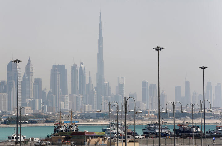 FILE PHOTO: The skyline is seen with the Burj Khalifa as ships dock at Port Rashid, in Dubai