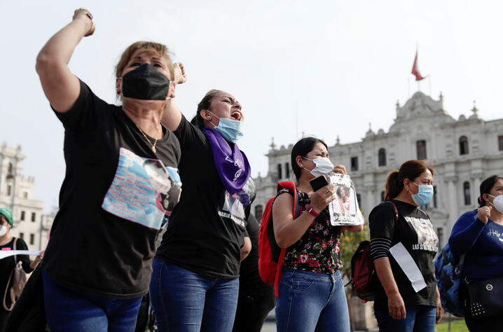 Women chant slogans during a protest to mark the International Day for the Elimination of Violence against Women, in Lima