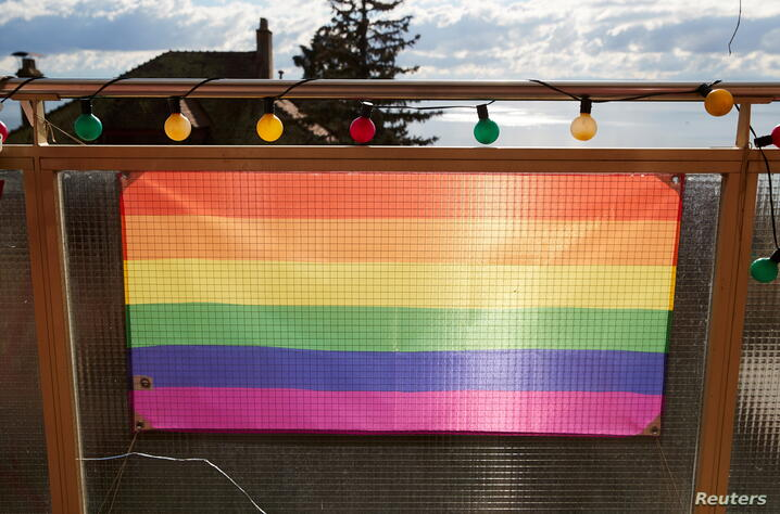 FILE PHOTO: A rainbow flag is pictured on a balcony ahead of a referendum on anti-homophobia law in Neuchatel