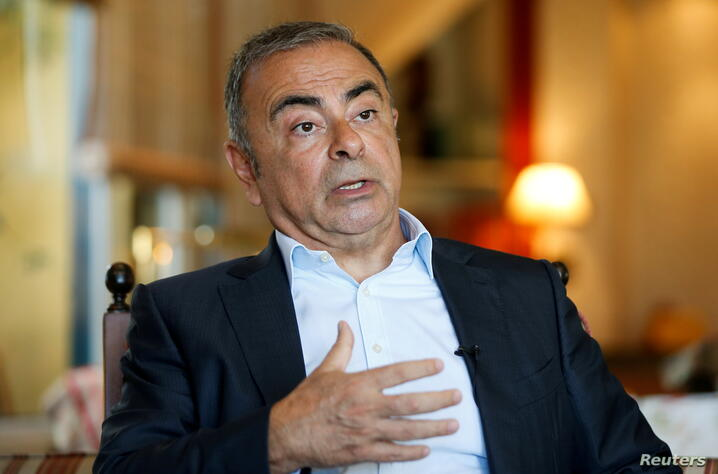 FILE PHOTO: Fugitive former car executive Carlos Ghosn, gestures as he talks during an interview with Reuters in Beirut