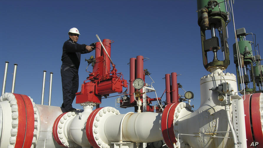 FILE - A worker checks valves on the Yapracik gas pipeline on the outskirts of Ankara, Turkey, Jan. 9, 2009.
