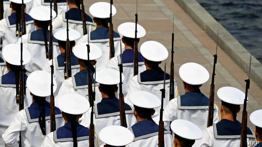 Sailors of the Russian Black Sea Fleet march as they prepare for Navy Day celebrations in the Crimean city of Sevastopol. Russia announced Wednesday that it had begun expanding and modernizing its Black Sea fleet based in Crimea with new ships and subm...