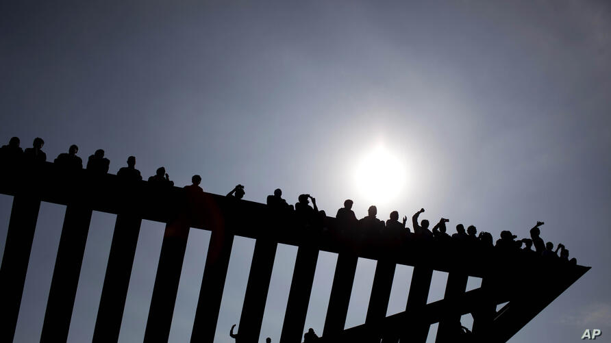 African migrants sit on top of a Holocaust memorial installation in Rabin's square, demanding rights and better treatment from the Israeli government, in Tel Aviv, Israel.Police spokesman Micky Rosenfeld said about 10,000 migrants marched through Tel ...