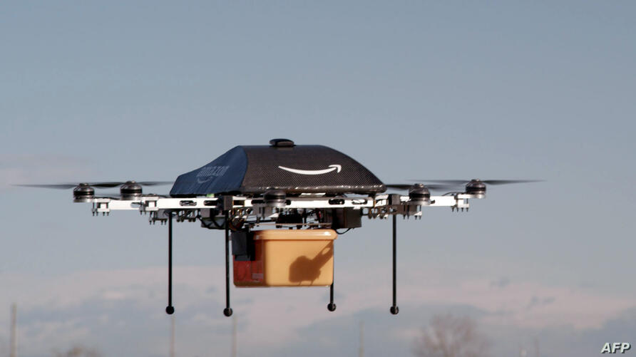 """Amazon CEO Jeff Bezos reveals a flying """"octocopter"""" mini-drone that will be used to fly small packages to consumers. His company was looking to the future with plans to use mini-drones to deliver small packages."""