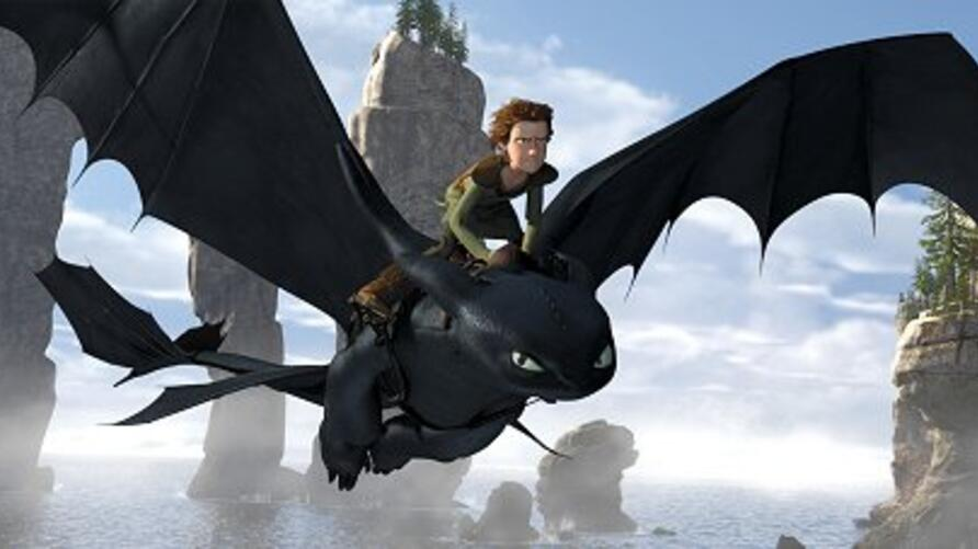 """Toothless, a Night Fury Dragon – the rarest of all kind – soars through the sky with Hiccup (Jay Baruchel) on his back in """"How to Train Your Dragon"""""""