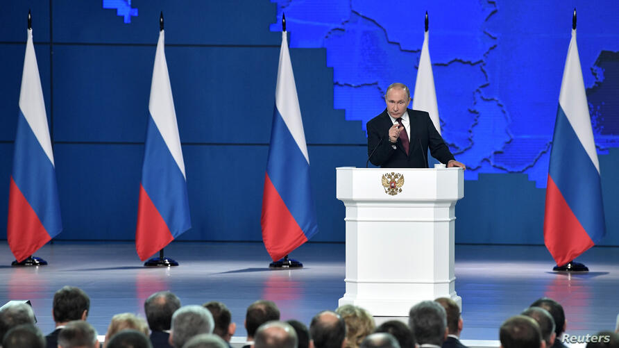 Russian President Vladimir Putin addresses the Federal Assembly, including the State Duma parliamentarians, members of the Federation Council, regional governors and other high-ranking officials, in Moscow, Feb. 20, 2019.