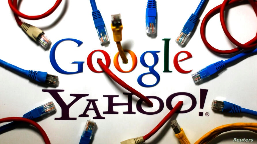An illustration shows the logos of Google and Yahoo connected with LAN cables in a Berlin office. The U.S. National Security Agency has tapped into communications links used by Google and Yahoo to move huge amounts of email and other user information a...