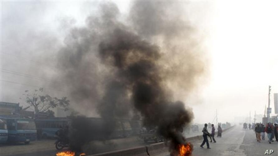 Supporters of Bangladesh's Islamic party Jamaat-e-Islami burn tires to block traffic during a general strike in Dhaka, Bangladesh, Thursday, Jan. 31, 2013. The party called a nationwide shutdown for Thursday to back its demand that the government stop a t