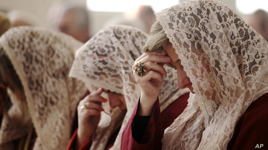 The women of Saint Afram Syrian Orthodox Church's choir pray during morning Christmas mass in Amman, Jordan. Syrian and Iraqi Orthodox Christian families attended morning mass of Christmas and pray for peace in their countries.
