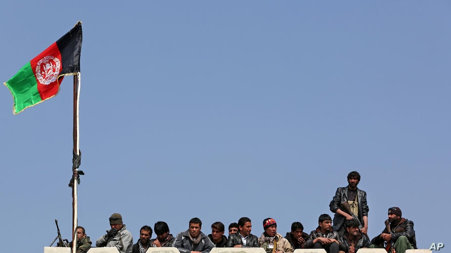 Bodyguards of Afghan presidential candidate Abdullah Abdullah stand guard as they listen to his speech during a campaign rally in Deh Sabz district on the outskirts of Kabul.