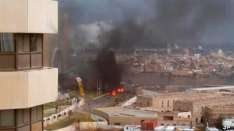 In this image made from video posted by a Libyan blogger, the Cortinthia Hotel is seen under attack in Tripoli, Libya,  Tuesday, Jan. 27, 2015.