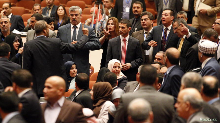 Some members of the newly elected Iraqi parliament point fingers at each other after an argument broke out at the parliament headquarters in Baghdad.