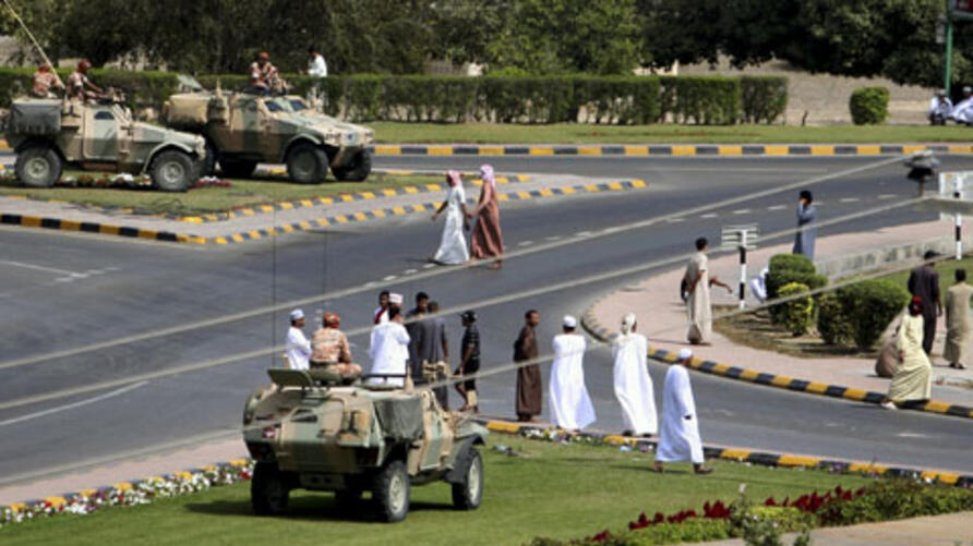 Soldiers keep watch from army armored vehicles at a roundabout after protesters dispersed in the northern industrial town of Sohar in Oman March 1, 2011