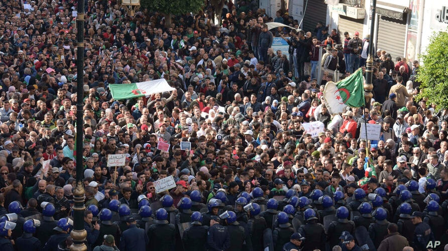 Algerian demonstrators take to the streets in the capital Algiers to protest against the government and reject the upcoming presidential elections, in Algeria, Wednesday, Dec. 11, 2019. Algeria's powerful army chief promises that a presidential…