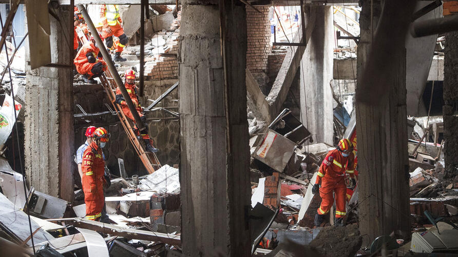 In this photo released by Xinhua News Agency, rescue workers search for survivors in the aftermath of a gas explosion in Shiyan…