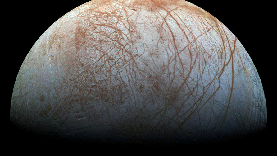 FILE PHOTO: A view of Jupiter's moon Europa created from images taken by NASA's Galileo spacecraft in the late 1990's,…