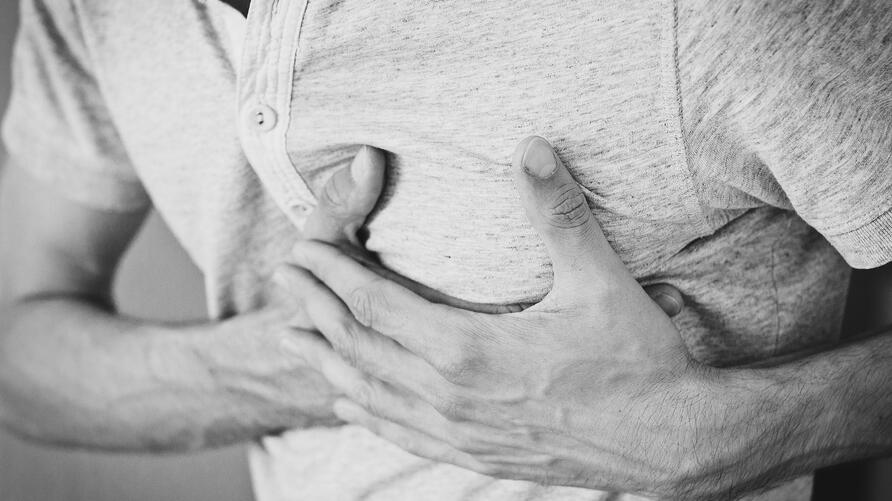 man hands on heart chest