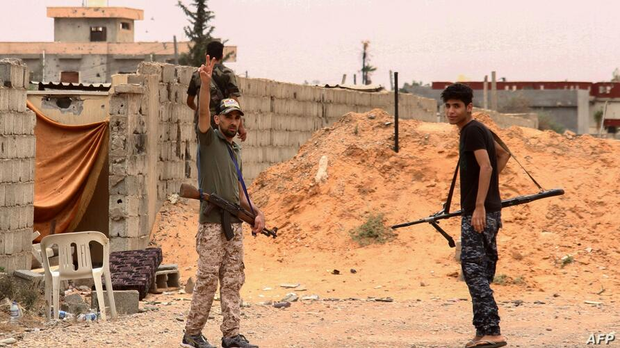 Fighters loyal to the internationally recognised Libyan Government of National Accord (GNA) are pictured during clashes with…