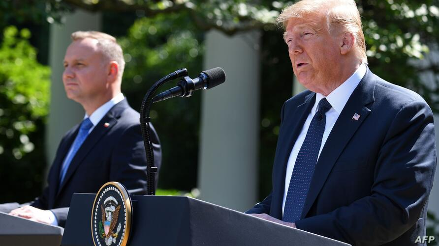 US President Donald Trump and Polish President Andrzej Duda hold a joint press conference in the Rose Garden of the White House…