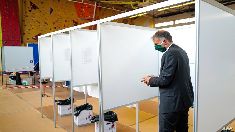 French EELV Green Party candidate for the metropolitan election in Lyon Bruno Bernard leaves the polling booth prior to cast…