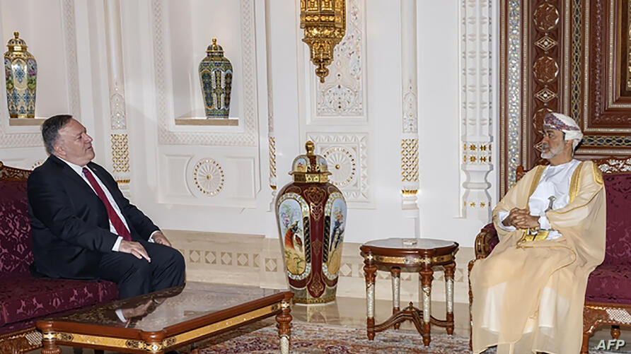 A handout picture released by the Omani Royal Palace on August 27, 2020 shows Sultan Haitham bin Tariq (R) receiving US…