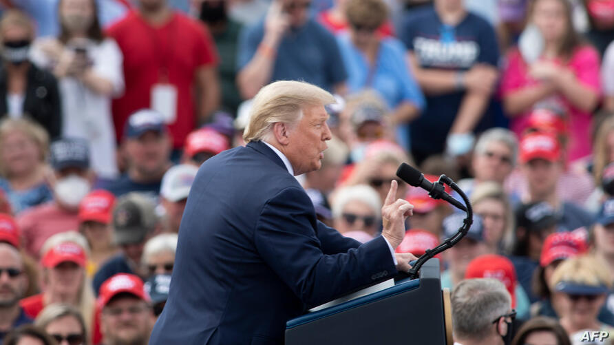 """US President Donald Trump speaks at a """"Make America Great Again"""" rally on October 15, 2020, in Greenville, North Carolina. …"""