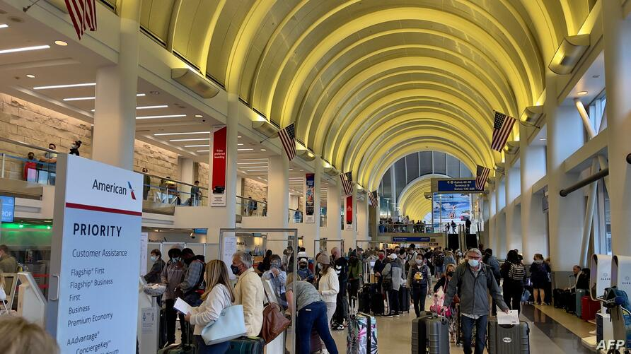 Passengers check in at the American Airlines counters at the Los Angeles International Airport (LAX) on April 24, 2021. (Photo…