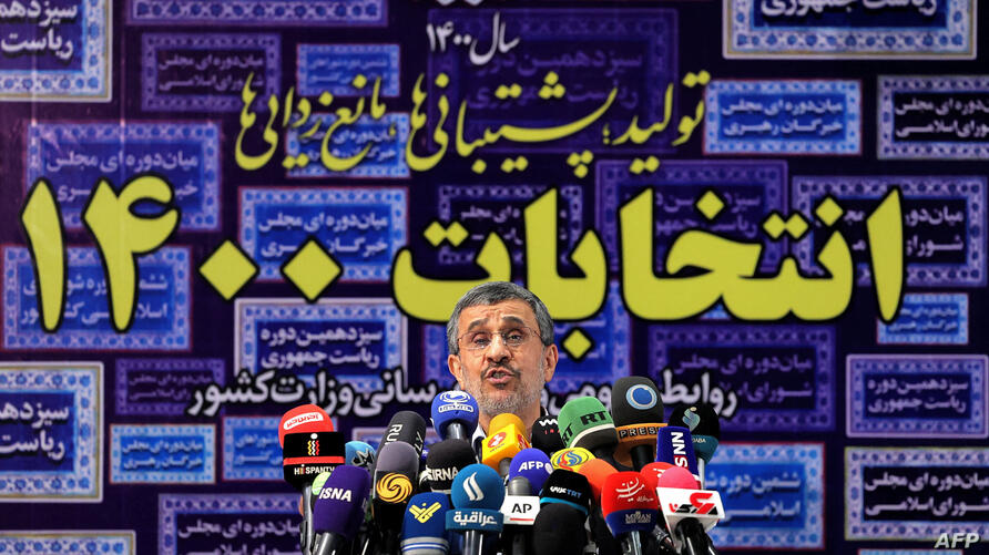 (FILES) In this file photo taken on May 12, 2021, Iran's former president Mahmoud Ahmadinejad addresses reporters at the…