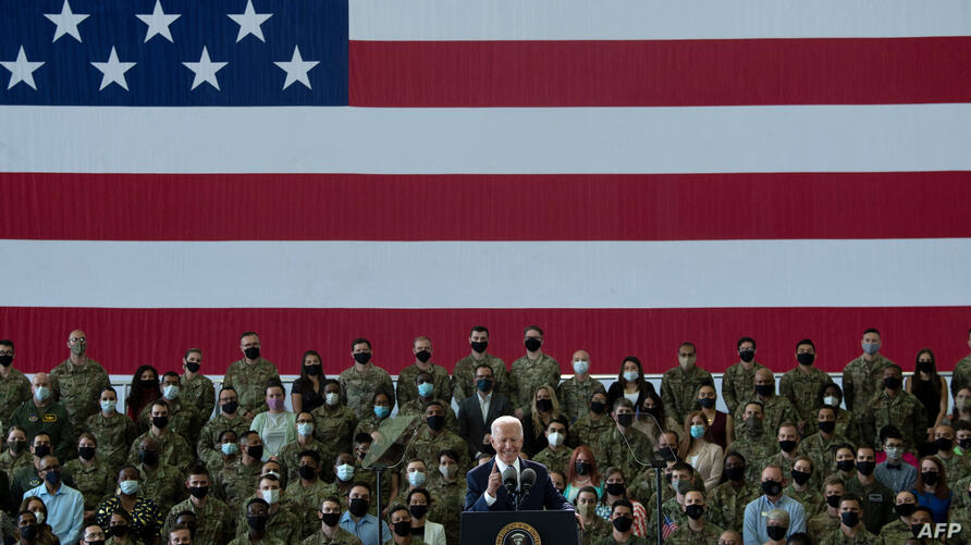 US President Joe Biden addresses US Air Force personnel and their families stationed at Royal Air Force Mildenhall, Suffolk,…
