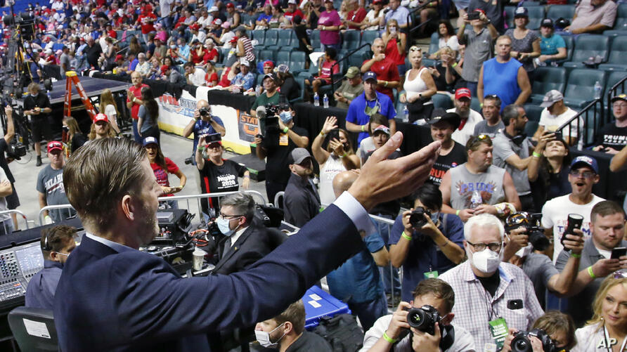 Eric Trump, the son of President Donald Trump, waves to supporters before a rally in Tulsa, Okla., Saturday, June 20, 2020. (AP…
