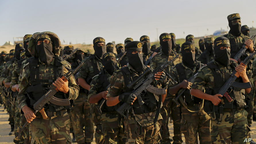 FILE - In this Dec. 11, 2014 file photo, Palestinian militants of the Islamic Jihad group take part in their military exercises…