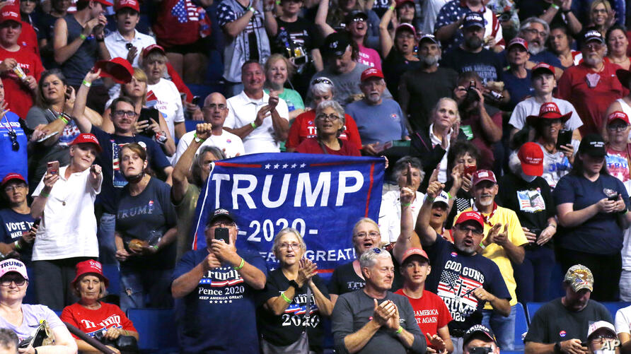 President Donald Trump supporters cheer Eric Trump, the son of President Donald Trump, not pictured, before a Trump campaign…