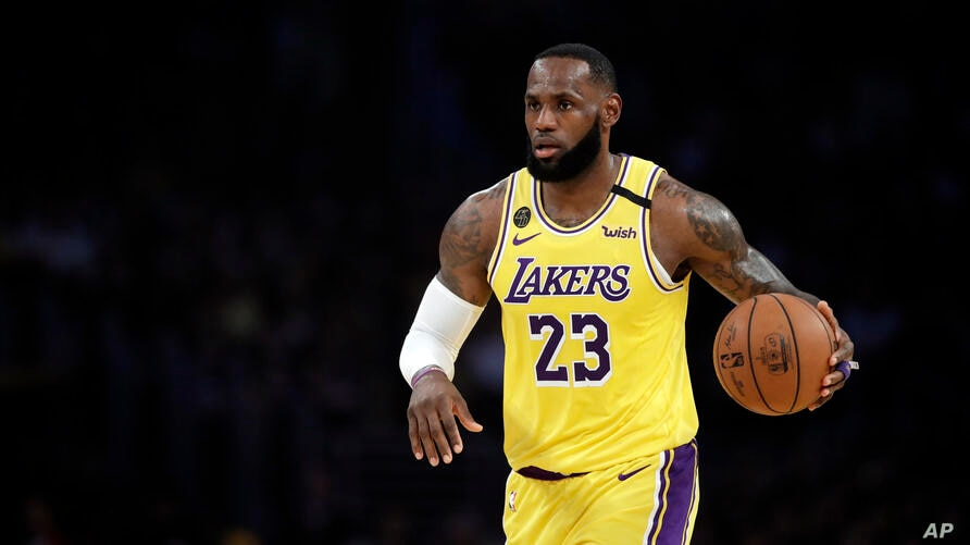 Los Angeles Lakers' LeBron James (23) dribbles during the first half of an NBA basketball game against the Brooklyn Nets…