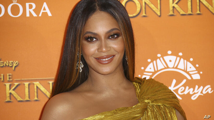 """FILE - This July 14, 2019 file photo shows Beyonce at the """"Lion King"""" premiere in London. President Barack Obama along with his…"""