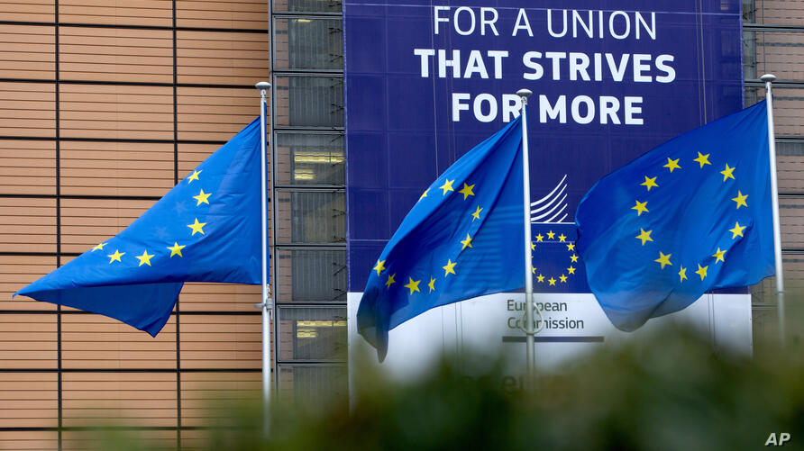 European Union flags flap in the wind outside EU headquarters in Brussels, Monday, Jan. 27, 2020. The U.K. is due to leave the…