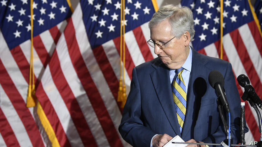 Senate Majority Leader Mitch McConnell of Ky., steps away from the microphone as he speak to reporters following the weekly…