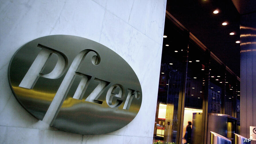 FILE - In this April 12, 2005 file photo, the world headquarters of Pfizer Inc. is seen in New York. Two key late-stage studies…